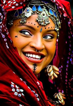 Traditional Headdress - Love how the photo captures her garb and expression.                                                                                                                                                      More