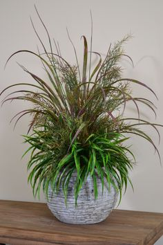 This grass arrangement is perfect for floor or large table to give texture and life to your setting from Trees n Trends florals
