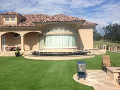 SYNLawn synthetic grass by Summit Flooring & Turf.  Call us for your free quote 816-886-2747.