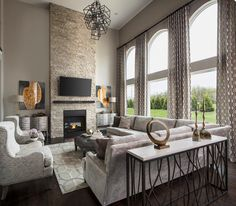 A Soaring Stone Fireplace And Wall Of Windows Defines This Great Room The Kensington