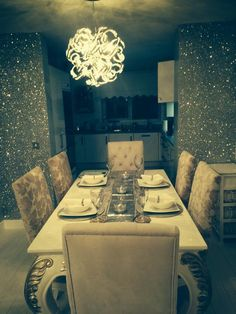 Our Silver #Glitterwallcovering from our Shades of Silver/Black collection used here in a fabulous dining room area.  Find out more about our #glitterwallpaper here - https://thebestwallpaperplace.com/browse-styles/glitter-wallpaper.html