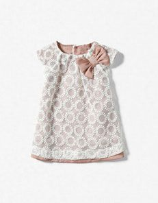 zara baby dress.   This would be so easy to do with a vintage curtain or tablecloth and a lining fabric.