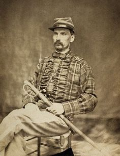 Scottish Confederate with Plaid shell jacket with ruffles and captain bars.