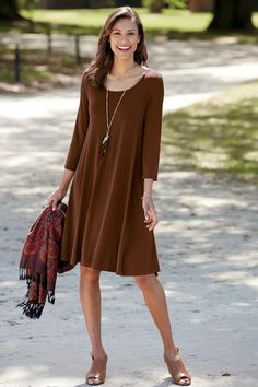 A 3/4-Sleeve Trapeze Dress in warm colors transitions seamlessly from summer to fall. Pair with a paisley scarf and open toe wedges for an in-between seasons look.