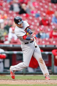 Allen Craig drives in a run with an infield single in the seventh inning of the game against the Cincinnati Reds. Cards won the game 7-6.  4-03-14