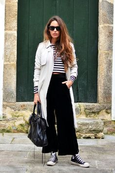 trench coat, cropped striped tee, Balenciaga bag, velvet culottes and hi-top Converse sneakers