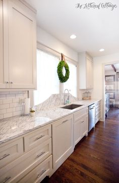 Revere Pewter Cabinets | Marble Countertop | KitchThe cabinets and trim are painted Revere Pewter by Benjamin Moore, and the ceiling and walls are White Dove.en