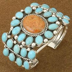 Cuff | Artist ? (Navajo).  Sterling silver, Sleeping Beauty Turquoise and Apple Coral