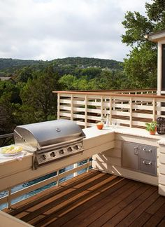 13 Upgrades For Your Outdoor Grill Area: Maximize your space. Having something built in to exactly fit a space is ideal, because you won't waste an inch. The outdoor kitchen shown here was ingeniously built right into the deck railing for a sleek look that really maximizes the space.