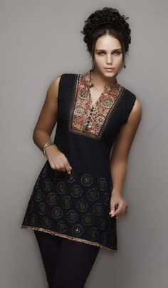 9 Black Kurti with contrasting neckline opulent and serene if made insilk.