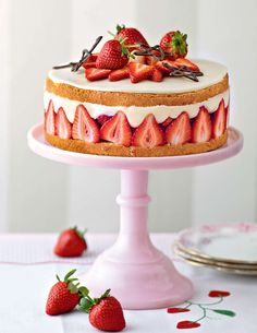 Mary Berry's Fraisier: a whisked egg sponge cake halved and filled with strawberries and a kirsch flavoured crème mouseeline. Topped with a layer of marzipan and piped chocolate decorations.