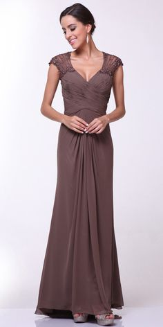 This figure flattering full length evening dress in brown by Cinderella Divine 1941 features delicate beading detailing the sheer cap sleeves. V-neck, ruched bodice and nicely gather front accentuated by the slightly flare floor length skirt. Designer: Cinderella Divine Item number:1941 Material: chiffon Back zipper Fully lined Soft cup inserts Approximately 65 inches from top of shoulder to hem Size XS S M L XL 2XL 3XL 4XL 5XL 6XL Bust 32.5 34.5 36.5 39 42 46 50 54 58 62 Waist 24 ...
