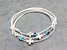 This listing is for ten Witness Bracelets. Made with: - adjustable white cotton waxed cord - silver plated cross - blue evil eye bead Ready for use. Christening Favors, Baptism Favors, Baby Shower Favors, First Communion Favors, Birthday Favors, Friendship Bracelets, Turquoise Bracelet, Wax, Etsy
