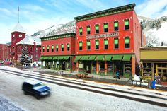 If it's a taste of historic Telluride you're after, head to the New Sheridan Hotel. Built in it blends Victorian charm with Egyptian cotton sheets and high-speed Internet. During the day, take a glider tour or set off on a gondola. Telluride Lodging, Colorado Usa, Telluride Colorado, The Places Youll Go, Places To Go, Hotel Spa, Hotel Reviews, Winter Getaways
