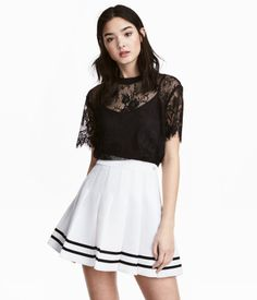 Black. Short-sleeved lace top with ribbing at neckline.