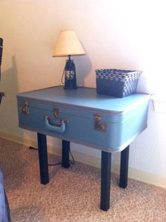 Suit Case Table - what an awesome idea in a travel-themed nursery or kids room! Perfect next to a glider.