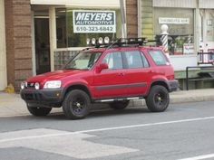 Red Honda CRV with lift kit