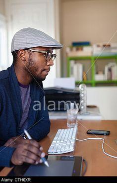 working at desk. © Blend Images / Alamy