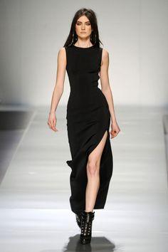 Long black dress with a slit... I d definitely change the shoes 08db73a3b7c