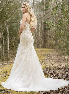 Look romantic in this strapless fit and flare lace and tulle gown with sequined lace appliques, lace up back, and chapel train. Gown available with a zipper closure as style 6450Z. https://www.lillianwest.com/lillian_west/6450