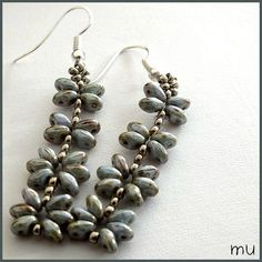 Earrings with Superduo's . From Mu.