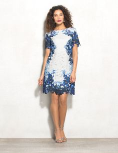 This dress is the perfect combination of elegant and trendy. An allover lace overlay in blue ombre hues takes your look to the next level. Imported.