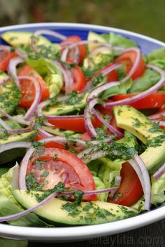 Tomato, avocado, lettuce and red onion salad with cilantro lime dressing!! Yes please!