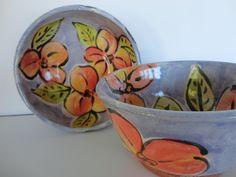 Set of Two Majolica  Bowls with Flower and Leaf Design on Blue Background. $25.00, via Etsy.