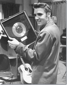 The one millionth record of Heartbreak Hotel is presented to Elvis Presley by RCA Victor, April 1956