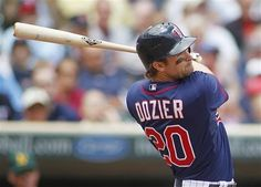 Minnesota Twins' Brian Dozier flies out to center field in the fifth inning of a baseball game against the Oakland Athletics, Wednesday, May 30, 2012 in Minneapolis