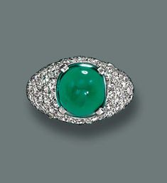 A FINE EMERALD AND DIAMOND RING, BY CARTIER   The cabochon emerald weighing 6.05 carats to the pavé-set diamond bezel and shoulders and plain hoop, with French assay marks for platinum and gold  Signed Monture Cartier, No. 27280 (indistinct)