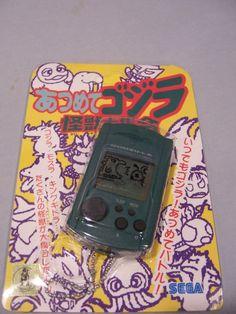 Sega Dreamcast Green Godzilla VMU  #retrogaming #HotDC  still sealed. Auction from the US.