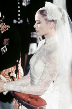 Grace+Kelly+wore+her+hair+in+a+big+bun+and+became+a+royal+icon+when+she+married+Prince+Rainier+in+1956.   - HarpersBAZAAR.com