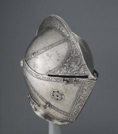 Close Helmet. Made in northern Italy c. 1560. Etched and partially blackened steel; brass. | © 2015 Philadelphia Museum of Art