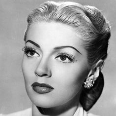 Lana Turner wears a 1940s updo with a middle part