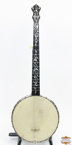 """From a private collection, Haynes Baystate made, one of two known examples, ivoroid plaque on dowel stick reads """"The Lewis Banjo"""", John C. Haynes"""