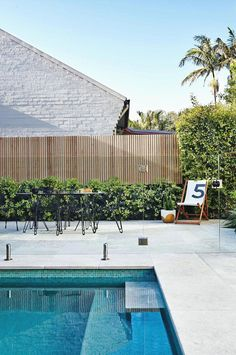 Pool and Landscape Design . Pool and Landscape Design. 5 Ideas for A Simple and Refined Garden Design Pool Fence, Backyard Fences, Pool Paving, Fence Around Pool, Cement Pavers, Glass Pool Fencing, Cement Garden, Concrete Fence, Paving Stones