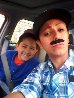 "When Yevette Vazquez dropped off her son Elijah at school last week, she noticed more cars were parked than usual. It turns out it was ""Donuts with Dad"" day at Fort Worth, Texas's, Sue Crouch Intermediate School. School Events, Kids Events, Fake Mustaches, Single Mum, Single Life, Worlds Best Dad, Dad Son, Mom Dress, Healthy Meals For Kids"