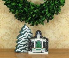 North Pole Christmas Gazebo shelf sitter keepsake by The Cat's Meow Village includes a poem on the back. Add this gazebo and other North Pole themed Cat's Meows to your holiday decor.