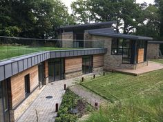 New Eco House, BerkshireThis unique home was designed on a beautifully wooded site but one which came with significant challenges. The required house was to be times larger than … Eco Homes, New Builds, Modern House Design, Larger, Challenges, Patio, Times, Mansions, House Styles