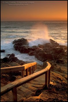 Wooden stairs leading down ocean wave crashing on coastal rocks at sunset, Leffingwell Landing, Cambria, California - ID# SNSM-1167a
