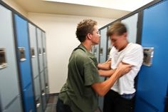 A student being pushed into some lockers. Finland's anti bullying campaign has positive results