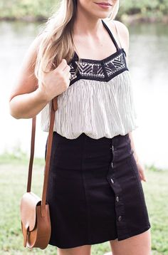 Prefer a black-and-white take on the classic festival look? Blogger LivingInColorPrint.com pairs an on-trend black denim skirt with a loose, detailed top. An unexpected twist? Adding a strappy bikini top underneath for a playful vibe. http://livingincolorprint.com/festival-finds-at-target/