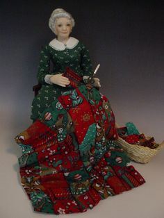 """Porcelain Dollhouse Doll: Granny Making A Christmas Quilt by Debbie Dixon-Paver ...part of THE CHRISTMAS ALPHABET: """"Q is for QUILT in green and red"""""""