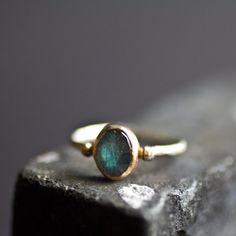 Forget diamonds, I think this would make a unique engagement ring.    Labradorite Mixed Metals. $175.00, via Etsy.