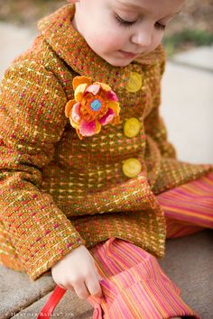 such a cute little coat to make...or just the flower pin.