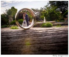 A bride and groom photographed through his wedding ring at Olbrich Botanical Gardens in Madison, Wi.