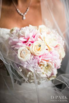 Beautiful blush pink, ivory wedding bouquet with elegant jewels designed by events by floral sensations