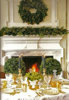 Christmas Mantel - Boxwoods - Green & Gold 50 Stunning Christmas Tablescapes - Christmas Decorating - Style Estate