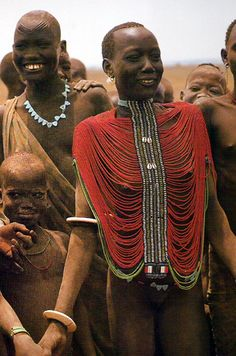 Africa | Dinka woman in her beaded 'corset' a sign of eligibility as these alluring loose bead bodices are worn by the Dink girls who are eligible for marriage.   Southern Sudan | © Carol Beckwith & Angela Fisher